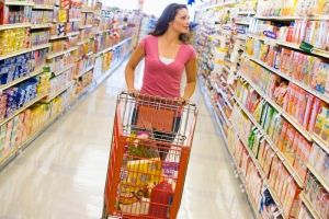 Young woman grocery shopping in supermarket